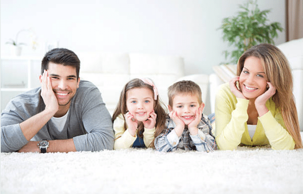 happy family lying on carpet